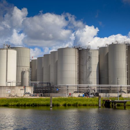 Industrial Tank Storage area with docking facility in a harbor in the Netherlands